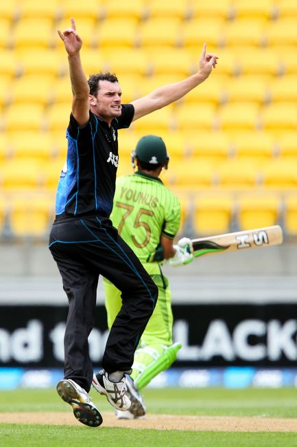 Kyle Mills celebrates a wicket.