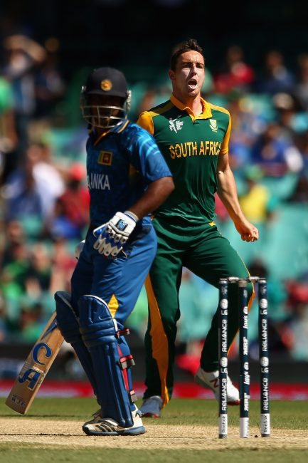 Kyle Abbott celebrates after taking the wicket of Kusal Perera.