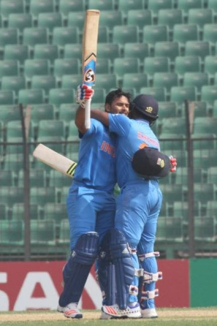 Sarfaraz Khan congratulates Rishabh Pant after his century.