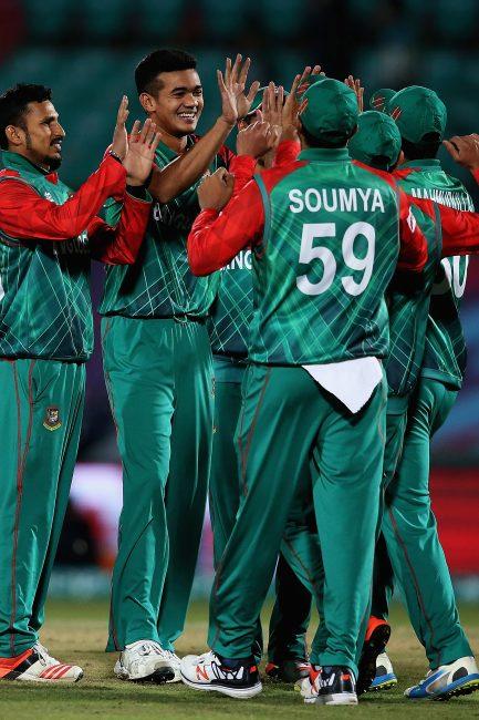 Bangladesh celebrates the wicket of Zeeshan Maqsood.