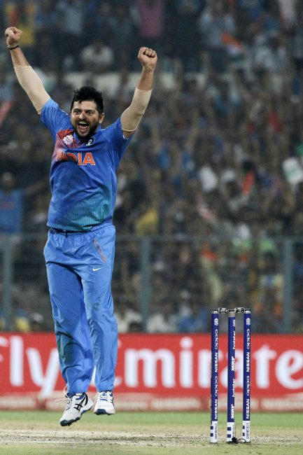 Suresh Raina celebrates the wicket of Sharjeel Khan.