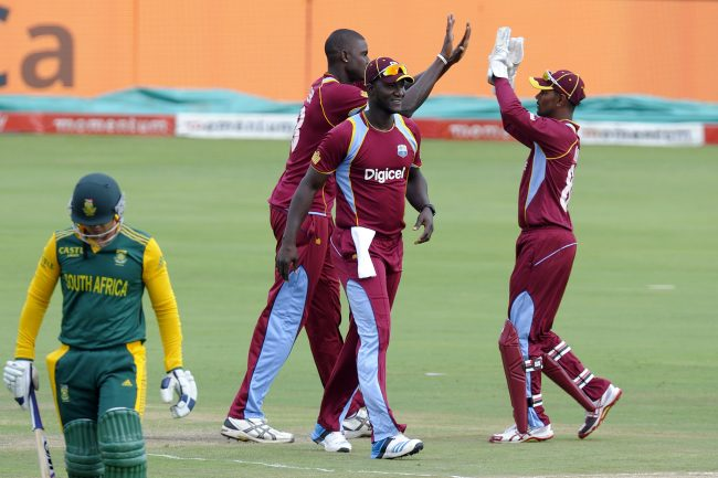 West Indies players celebrate a wicket.