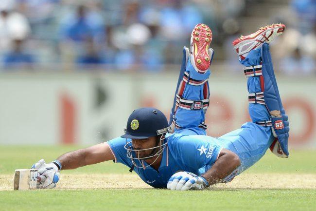 Ambati Rayudu dives to make his ground.