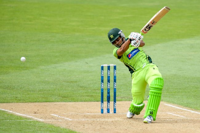 Umar Akmal plays a shot.