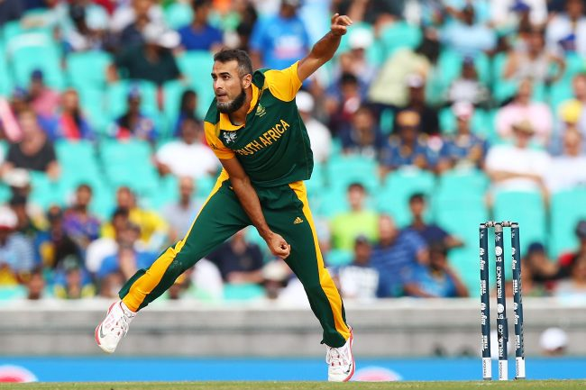 Imran Tahir runs in to bowl.