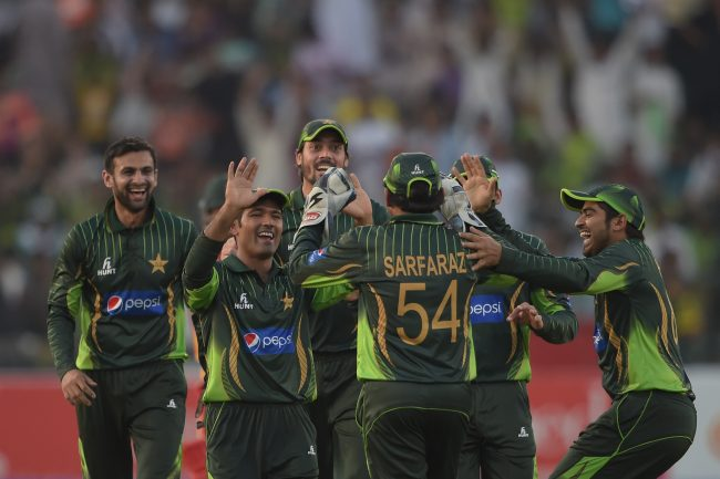 Pakistan players celebrate a Zimbabwe wicket.