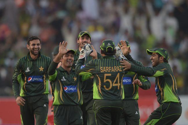 Pakistan players celebrate a Zimbabwe wicket.