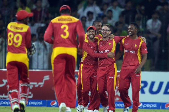 Zimbabwe players celebrate the wicket of Mohammad Hafeez.