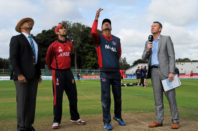 Captains and match official during the toss.