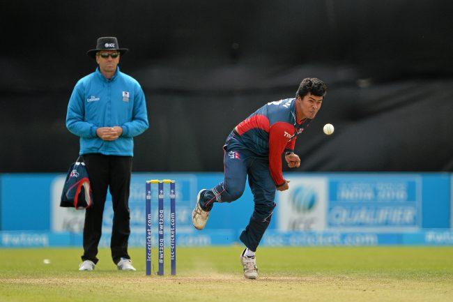 Karan KC bowls during the match.