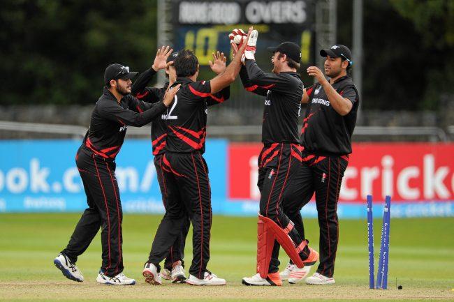 Hong Kong players celebrate the wicket of Calum MacLeod.