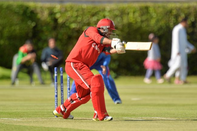 Zeeshan Maqsood of Oman is bowled by Dawlat Zadran.