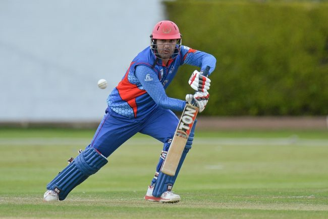 Mohammad Nabi of Afghanistan in action against Oman.