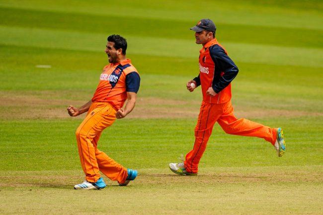 Mudassar Bukhari (L) celebrates the wicket of William Porterfield.