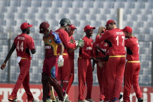 Zimbabwe U-19 players celebrating the fall of a West Indies U-19 player.