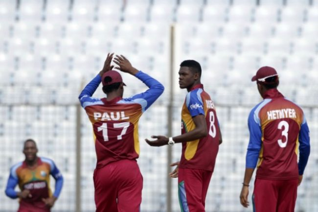 West Indies U-19 celebrates the fall of a Zimbabwe U-19 wicket.