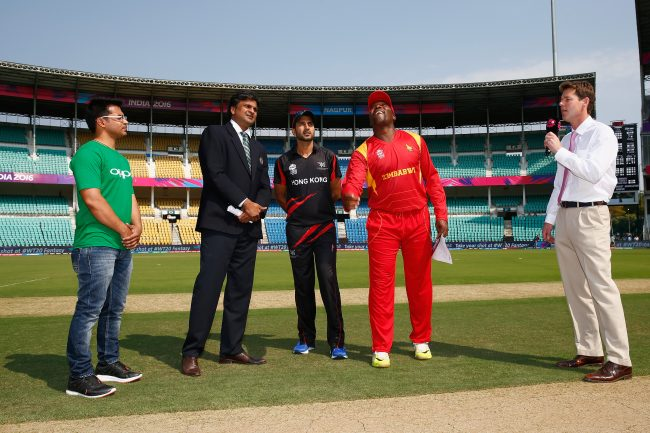 Captain Hamilton Masakadza of Zimbabwe tosses the coin with Captain Tanwir Afzal of Hong Kong.