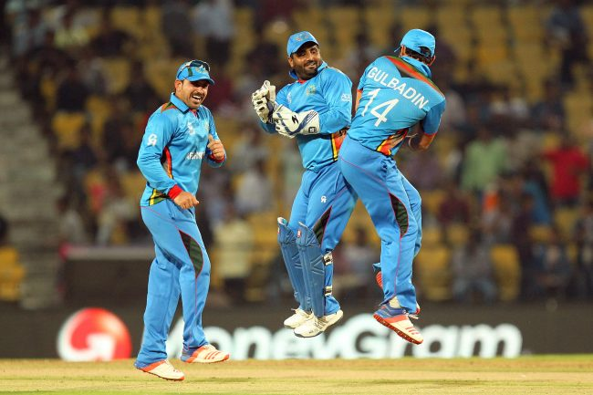 Mohammad Shahzad and Gulabdin Naib celebrate Afghanistan's comfortable win over Zimbabwe