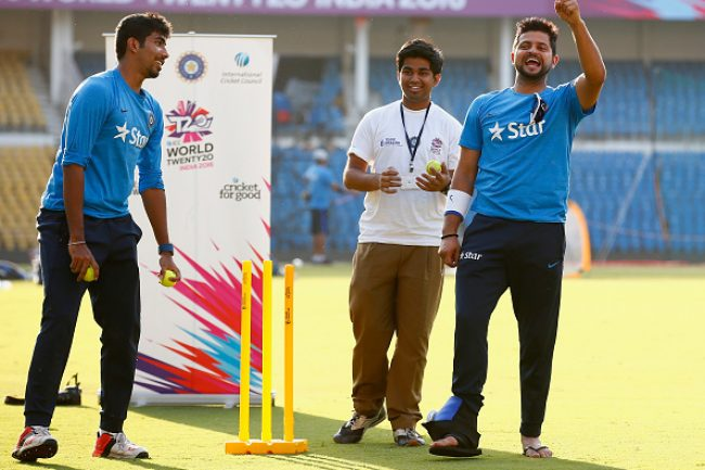 Suresh Raina and Jasprit Bumrah take part in a game of cricket with local kids during the ICC Cricket For Good and Team Swachh cricket clinics in partnership with UNICEF.