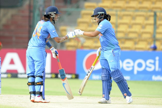 Harmanpreet Kaur and Veda Krishnamurthy in action against Bangladesh.