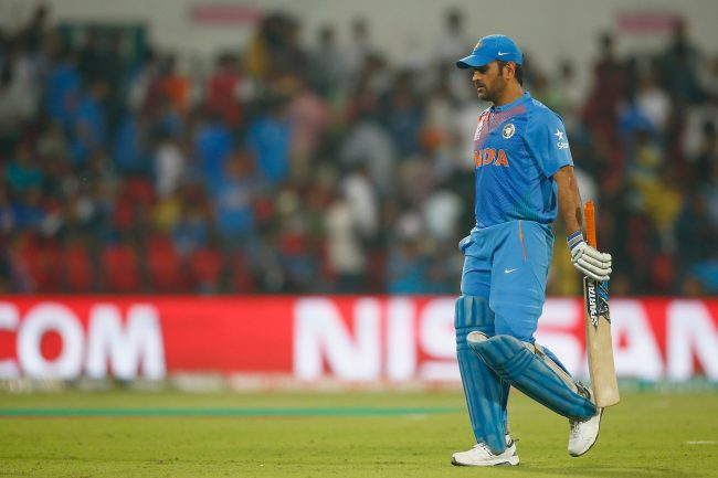 MS Dhoni walks back after being dismissed.