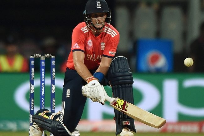 England batsman Joe Root plays a shot during the World T20 cricket tournament match between England and South Africa at The Wankhede Stadium in Mumbai on March 18, 2016.  / AFP / PUNIT PARANJPE        (Photo credit should read PUNIT PARANJPE/AFP/Getty Images)