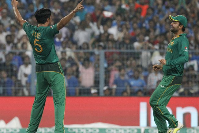 Mohammad Amir celebrates the wicket of Rohit Sharma.