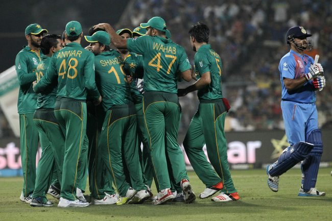 Pakistan celebrates the wicket of Suresh Raina.