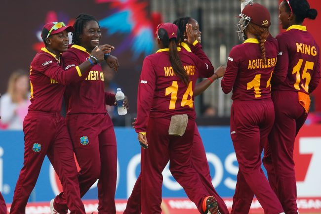 CHENNAI, INDIA - MARCH 20:  Deandra Dottin of the West Indies (2nd L) is congratulated after catching out Sanjida Islam of Bangladesh during the Women's ICC World Twenty20 India 2016 Group B match between West Indies and Bangladesh at the Chidambaram Stadium on March 20, 2016 in Chennai, India.  (Photo by Christopher Lee-IDI/IDI via Getty Images)