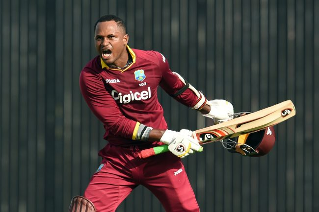 Marlon Samuels celebrates after scoring his century