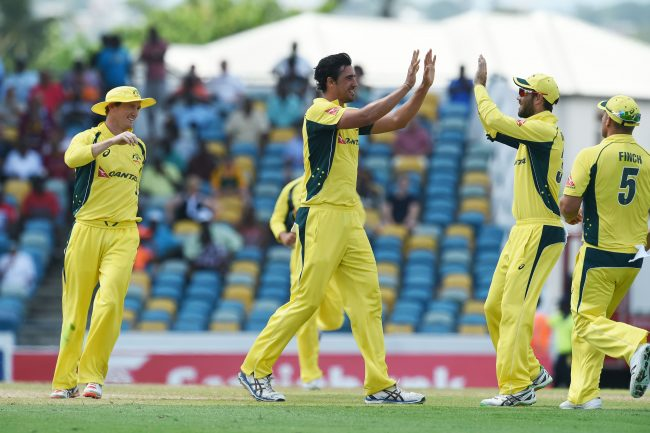 Mitchell Starc celebrates after dismissing Andre Fletcher